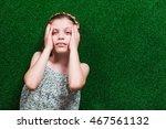little girl is lying on...   Shutterstock . vector #467561132