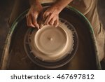 hands of potter making a pot in ... | Shutterstock . vector #467697812