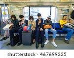 tokyo  april 10   passengers in ... | Shutterstock . vector #467699225