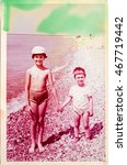 Small photo of USSR, ABKHAZIA, LESELIDZE - CIRCA 1978: Vintage photo of two kids on the sea shore