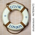 Small photo of Titanic lifesaver with London and date of 1912 on it.