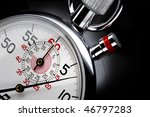 Small photo of Close up shot of beautiful stopwatch shot on black background with space for copy
