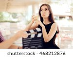Small photo of Upset Actress Holding a Glass in Movie Scene - Portrait of funny girl acting in a commercial