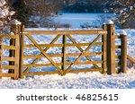 A Wooden Gate Through Snowy...