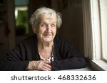 Elderly Woman Smiling Sitting...