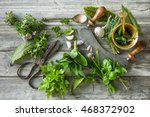 Small photo of fresh kitchen herbs and spices on wooden table. Top view