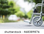 empty wheelchair parked in park | Shutterstock . vector #468389876
