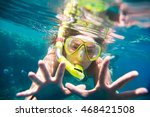 girl engaged in snorkeling in... | Shutterstock . vector #468421508