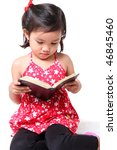 little asian girl reading a book - stock photo