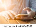 young man using smartphone ... | Shutterstock . vector #468667382