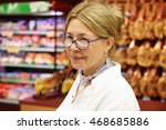Small photo of Half profile portrait of tired middle-aged woman with fair hair at supermarket dressed casually remembering hard day at work as accountant general, looking at cashier while shopping at grocery store