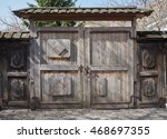 Old Wooden Gate With A Wooden...