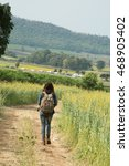 girl wearing a backpack walking ... | Shutterstock . vector #468905402