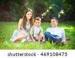 happy family relaxing at the... | Shutterstock . vector #469108475