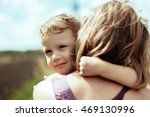 boy embraces mum | Shutterstock . vector #469130996