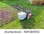 cutting and bagging grass and... | Shutterstock . vector #469184552