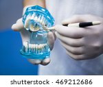 dentist  showing on a jaw model ... | Shutterstock . vector #469212686