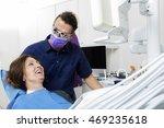 dentist examining happy female... | Shutterstock . vector #469235618