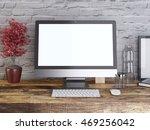 mockup monitor on a wooden desk ... | Shutterstock . vector #469256042