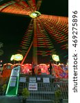 "Small photo of BANGKOK, THAILAND - APRIL 28: long exposure abstract blurry light, player name ""Booster"" in amusement park at night April 28, 2016 at Bangkok, Thailand."