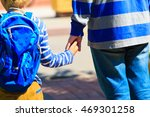 father holding hand of son on... | Shutterstock . vector #469301258