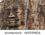 Small photo of Large faces on ancient stone temples Cambodia, showing weathering and environmental damage due to acid rain.