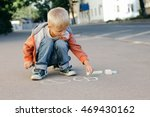 boy draws colored chalk on... | Shutterstock . vector #469430162