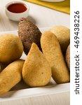 mixed brazilian snack. | Shutterstock . vector #469438226