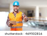 smiling manual worker in blue...