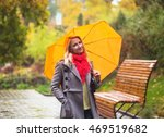 Young Woman With Red Umbrella...