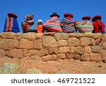 Stock photo quechua ladies and a young boy chatting on an ancient inca wall cusco province peru 469721522