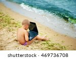 boy sitting with a laptop on... | Shutterstock . vector #469736708