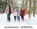Family Walking Dog Through...