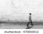 Man Walking Fast On The Grey...