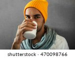 handsome young man drinking... | Shutterstock . vector #470098766