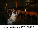 young girl in the church | Shutterstock . vector #470150498