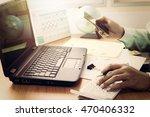man working with calculator ...   Shutterstock . vector #470406332