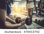 healthy woman with dumbbell in... | Shutterstock . vector #470413742