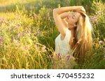 beautiful young woman in field | Shutterstock . vector #470455232
