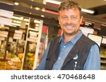 shop assistant in a supermarket ... | Shutterstock . vector #470468648