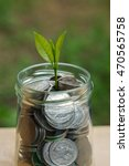 plant growing out of coins | Shutterstock . vector #470565758