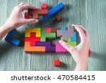 Stock photo hand holding wooden puzzle element hand sets the last element of the puzzle the concept of 470584415