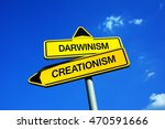 Small photo of Darwinism vs Creationism - Traffic sign with two options - conflict between evolutionary theory and christian religious belief of creator and creation of universe by God. Holy Bible vs science