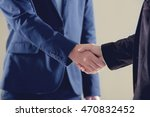 businessmen shaking hands on... | Shutterstock . vector #470832452