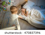 baby in cot crying and trying... | Shutterstock . vector #470837396