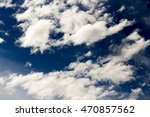 Small photo of Picturesque middle level stratocumulous and altostratus with low stratus cloud formations on a warm sunny afternoon in autumn are contrasted against the blue Australian sky.