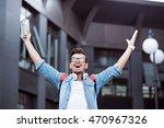 cheerful man standing outdoors | Shutterstock . vector #470967326