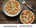 two pizzas on wooden background | Shutterstock . vector #470978552