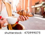 Female Hands Holding Croissant...