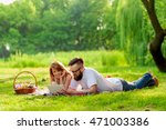couple lying on a picnic... | Shutterstock . vector #471003386